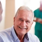 Smiling senior man in medical clinic.